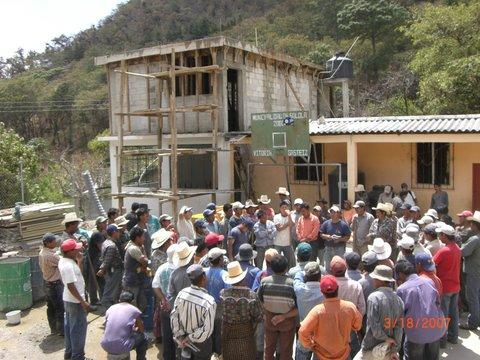 Village volunteers work on new classrooms