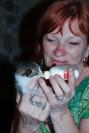 Dale feeding a kitten