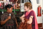Wendy accepts a gift from the micro loan women